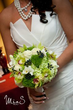 Green wedding bouquet with blue, white and red accents -- Bank of Memories & Flowers