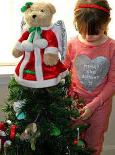 4 Holiday Traditions to start with your family this year - like letting kids decorate their own kid-friendly Christmas tree for their room #ChosenByKids #ad