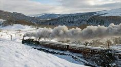 Ffestiniog Railway, Porthmadog -.Tan y Bwlch, Snowdonia, North Wales. A 22 km ride through the stunning meadows, woodlands, lakes and waterfalls within Snowdonia National Park.