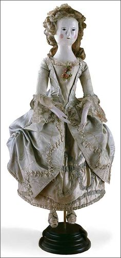 Bewigged and begowned in lace and embroidered silk, this doll, now in Colonial Williamsburg's collections, must have been the treasure of some eighteenth-century girl. Photo by Hans Lorenz.  Colonial Williamsburg