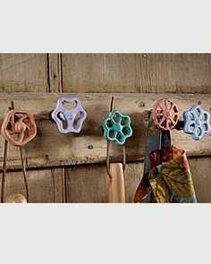 Vintage faucets, brightly painted and used as wall hooks.