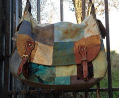 raffaela gottardelli slow cloth bag   hand stitching, rusted and discharged fabric, old jeans and old leather reclaimed