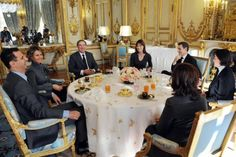 France's President Nicolas Sarkozy (2nd R), his wife Carla Bruni-Sarkozy (3rd R), and his advisor Claude Gueant (3rd L) share a working lunch with Syria's President Bashar al-Assad (L) and his wife Asma (2nd L) at the Elysee Palace in Paris December 9, 2010.