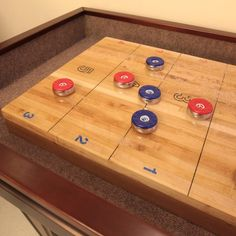 The Texan-made Worthington Shuffleboard possesses its own distinctive style, infused with hints of an Italian Gothic design. Its maple wood cabinet comes in a variety of finishes, from aged matte black to deep cherry. Luxury Gifts For Men, Wood Cabinets, Matte Black, Gothic, Cherry, It Is Finished, Deep, Bobs, Tables