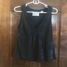 Anthropologie Shirt super cute black tank top from Anthropologie! The brand is Deletta! it is in very good condition with no flaws! MAKE ME AN OFFER, WE CAN NEGOTIATE Anthropologie Tops