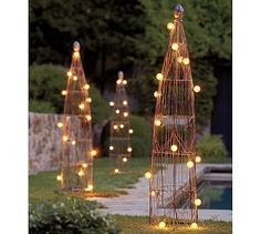 Really cute idea for a garden trellis.   Just imagine it with a clematis or roses growing among the   lights!