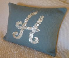 Vintage Button Monogram Pillow by Letter by letterperfectdesigns. $70.00, via Etsy.