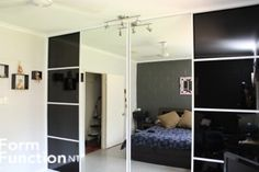 A flawless finish to this room.  Black Glass composite Sliding Doors with 2 mirror sliding doors.  Wall to wall - floor to ceiling.