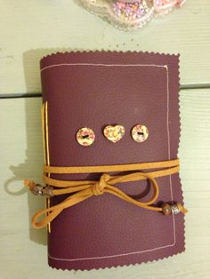 I made this leather note book :) here is the link to kirstie allsopp's website and the step by step guide ... http://www.channel4.com/4homes/how-to/crafts/how-to-bind-a-book