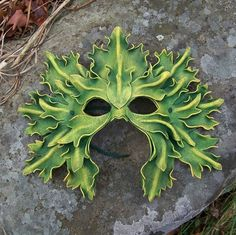 Green Man leather mask from MythicalDesigns on Etsy.  The whole shop is stunning.