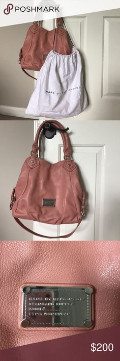 """Marc by Marc Jacobs handbag Marc by Marc Jacobs Hobo Bag - inside zippered pocket has some make-up stains - see last pic.  There are no wear marks anywhere else.  Also have matching wallet seen in last pic.  Duster included. Dark blush color  Pebbled leather 7.5"""" Handle drop Silver tone hardware 1 Interior zip pocket, 2 interior slip pockets  Leather tabs lobster claw hook at bag opening Push snap closure Marc by Marc Jacobs Bags Hobos"""