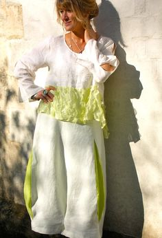 Petal Top in cream linen and silk £195 over Bubble Skirt £225.  terrymacey.com
