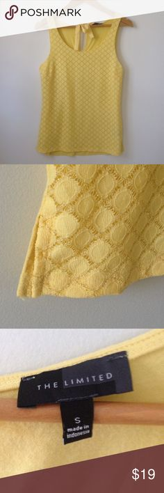 """The Limited mixed media top The Limited sunny yellow and gold sleeveless top.  Unique gold mesh overlay on the front. Mix media top.  Back is a soft knit with bow closure.    Slits at the sides and bust darts.  Length is 23"""".  Front shell is 98% nylon and 2% other fibers. Front lining is 100% polyester.  Back is 95% viscose rayon, 5% spandex.     I also have this top in white and another in black. The Limited Tops"""