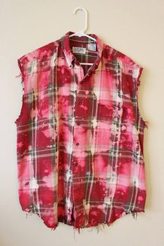 This shirt is a great 90s vintage cotton flannel plaid.  Its a vintage red and gray plaid that weve distressed and splatter bleached.  Weve done all the hard work for you, its beautifully frayed and aged strategically all over the shirt - collar, bottom hem, arms holes, etc.  Heres your info on it -  - Size Large, check measurements - Across chest flat, pit to pit - 25 (50 around)  - Shoulder seam down, front - 29  - Shoulder seam down , back - 31  - Neck around inside collar - 18  If you…