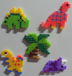 Fused bead (Perler, Hama) magnets with a prehistoric theme. Choose from several different dinosaurs or a palm tree.