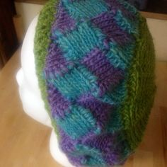 """The term """"entrelac"""" is derived from a French verb """"entrelacer"""". In English, this means """"to interlace"""". Knitted entrelac looks woven/interlaced. Each round or row…"""