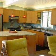 yellow-wood-mid-century-modern-kitchen-cabinets-feat-island-and-cream-countertop-feat-grey-backsplash-and-double-glass-window-also-some-round-shape-white-stool-at-marvelous-decoration-300x300.jpg (300×300)