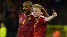 Kevin De Bruyne (R) of Belgium celebrates with Vincent Kompany after scoring their second goal during their UEFA EURO 2016 qualifier against Bosnia and Herzegovina