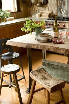 The use of wood in this pic is cool - hardwood floors, wooden stools Rustic kitchen comfortable