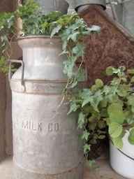 milk can planter table - Google Search