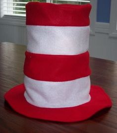 I made one of these tonight for Nate for Dr. Seuss parade at school. Mine is 15 inches tall and has five stripes and a brim lining that is white with black polka dots. I sewed two pipe cleaners to the inside to make it stand up tall.
