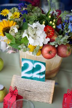 country inspired centerpiece with apples and flowers -cute table numbers too