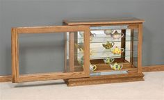 Amish Small Console with Sliding Door Mt. Eaton Collection Our Small Console with Sliding Door is Amish handcrafted from solid hardwood. This Amish Curio Cabinet has a conveninet Sliding Door on