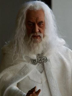 Gandalf the White: Gandalf was created from the Tonner Dumbledore doll. Rescuplted, repainted with applied hair and beard. Then costumed as Gandalf the White from the movie Lord of the Rings.