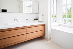 wood vanity; all white color scheme