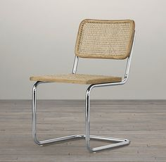 RH's Bauhaus Side Chair:Inspired by Marcel Breuer's iconic 1928 Cesca Chair, considered one of the most important designs of the 20th century, our reinterpretation pairs caning and wood trim with the industrial-age aesthetic of cantilevered tubular steel. Drifted oak finishes imbue it with a contemporary attitude.