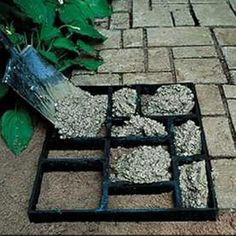 DIY gravel path. Take multi picture frame & fill with concrete. Beeswax or cooking oil on wood will aid in the release.
