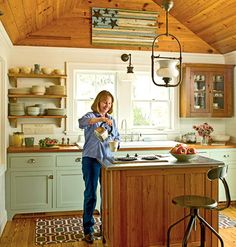 Marshfront Kitchen, After   Reclaimed heart-pine counters, open shelves, and a vaulted ceiling exude vintage charm. The Morgans found the 1952 double drain-board sink at a Georgia roadside antiques stand.