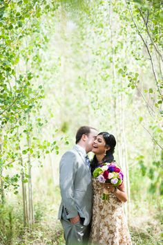 Devils Thumb Ranch, Hindu Mountain wedding, Outdoors, bride and groom, lush green leaves, vibrant colorful floral bouquet, bride and groom, action shot