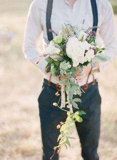 have the groom hold the bouquet for a shot. by Jessica Claire