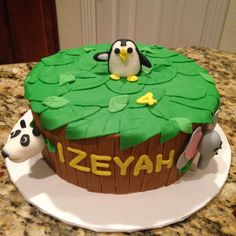 Zoo animals almond cake with penguin, elephant, and panda.  https://www.facebook.com/sweetnsassycakesbyeva