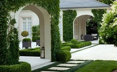 Beautifully tailored landscape, clean white exterior