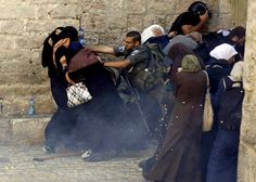 Witness how this coward is trying to stop these devout and innocent women from accessing the Alaqsa