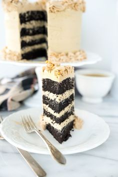 Black Cocoa Chocolate Espresso Cake. My new favorite cake recipe! Deep, dark, delicate crumbed chocolate cake enrobed in a blanket of rich, creamy espresso cream cheese frosting.| thesugarcoatedcottage.com
