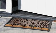 Rubber doormat with tree and text; Welcome friends