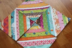 A great tutorial for a string quilt block using a paper pieced method. Use this great technique with fabric from the Fabric Shack at http://www.fabricshack.com/cgi-bin/Store/store.cgi