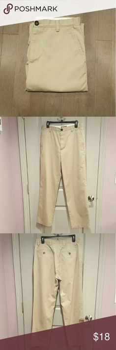 """Dockers Flat Front Pants Flat front chinos in a medium khaki shade. (Pic 4 most closely represents color.) Straight leg. Cotton/Poly twill blend helps resist wrinkling.  Worn a few times but in very good condition.   60% cotton, 40% polyester.  Sized 32 x 32. However, inseam measures closer to 31"""" Pants Chinos & Khakis"""