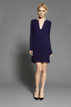 Long sleeve dress with cut out neck detail