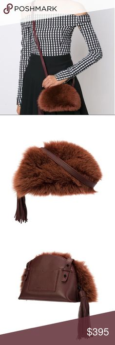Loeffler Randall Fur Crossbody Bag Loeffler Randall Fur Crossbody Bag! Brand new!  Brown fur crossbody bag Designer Style ID: CBPOUCHFFN Color: Caucho/Mrn Made in Italy Composition: leather 100% Fox fur 100% I love this bag but I like to carry larger bags. Loeffler Randall Bags Crossbody Bags