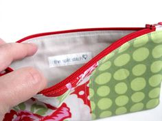 Super cute pouch - But really cool is how she does her labels - She uses a Brother label maker and iron-on fabric tape!! Didn't even know they made such a thing!! She has a link to where you can order it on Amazon. :)