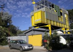 Ecotech Gives a 1950s Bungalow a Bright Yellow Shipping Container Addition