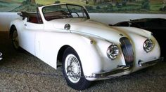 1954 Jaguar SS | More here: http://mylusciouslife.com/stylish-home-luxury-garage-design/