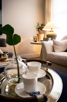Luxurious designs of Richard Brendon teaware in the ground floor living space of Kenure House - Kenure House project by Echlin London design studio. Luxury home located close to Holland Park, London including many  contemporary and British designs. Featuring on the Martyn White Designs Blog www.martynwhitedesigns.com
