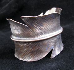 form folded Anticlastic copper feather cuff bracelet