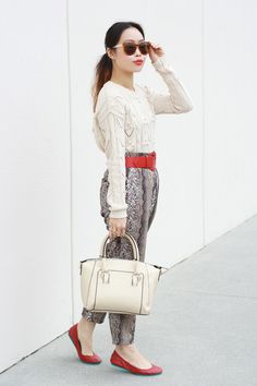 Shop this look for $100:  http://lookastic.com/women/looks/cable-sweater-and-shopper-handbag-and-ballerina-shoes-and-belt-and-wide-leg-pants/1244  — White Cable Sweater  — White Leather Tote Bag  — Red Leather Ballerina Shoes  — Red Leather Belt  — Grey Print Wide Leg Pants