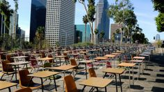a demonstration outside the Los Angeles Unified School District headquarters.  375 desks represent the average number of students that drop out of the school district each WEEK. Image by Richard Vogel via AP